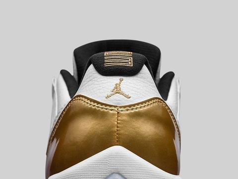 AIR-JORDAN-11-RETRO-LOW-WHITE-METALLIC-GOLD-DETAIL-2.jpg